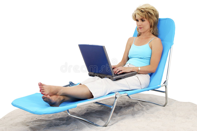 Woman On Laptop In Lounge Chair stock images