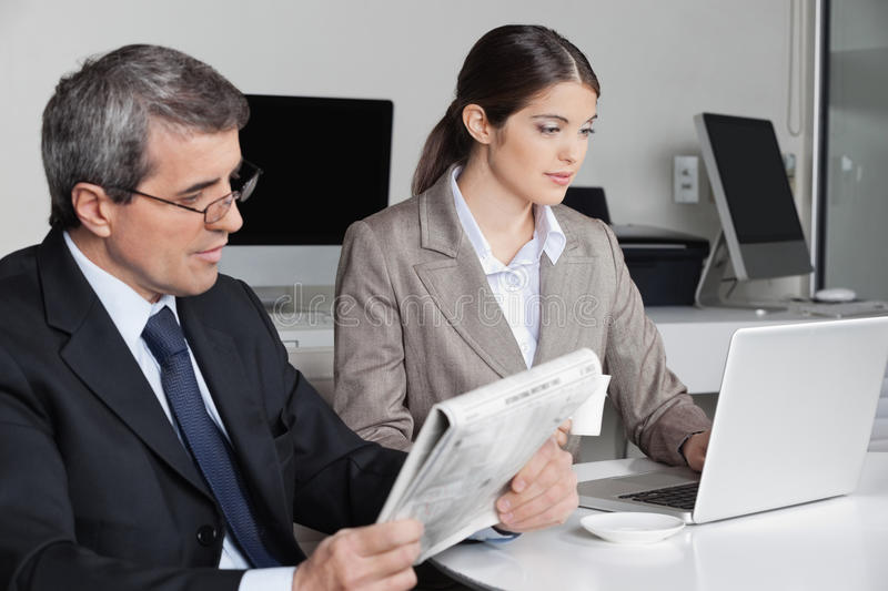 Download Woman With Laptop And Man Reading Stock Image - Image: 27628371