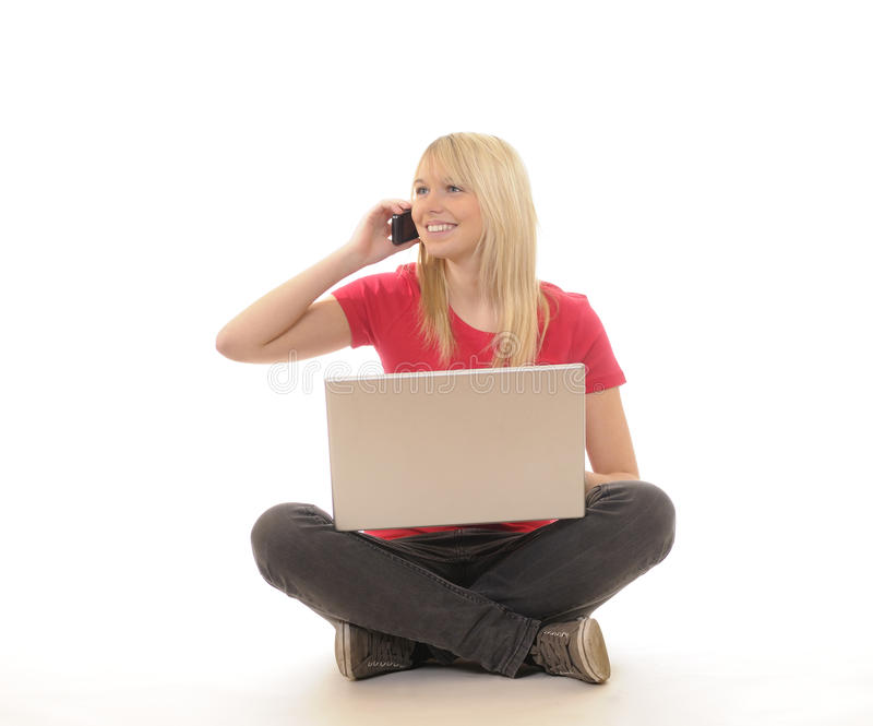 Woman with laptop and mobile phone royalty free stock image