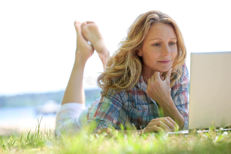 Download Woman on laptop outside stock photo. Image of lady, relaxing - 25432904