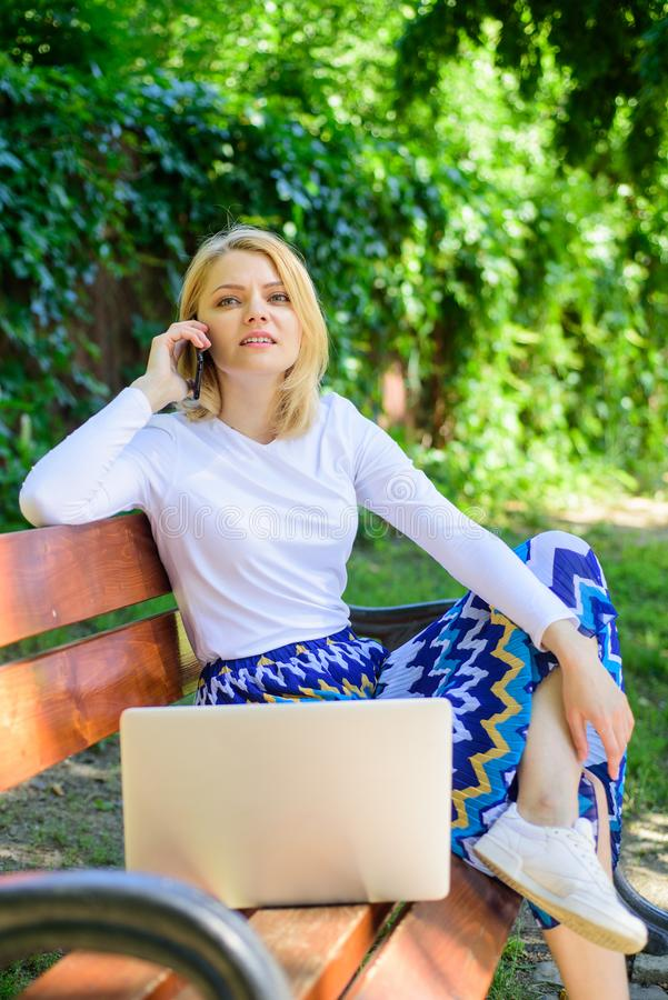 Woman laptop in park enjoy green nature and fresh air. Girl dreamy takes advantage of online shopping. Girl sit bench stock photos