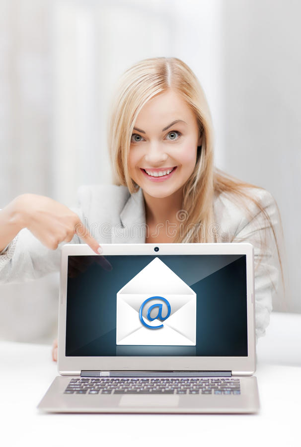 Woman with laptop pointing at email sign royalty free stock images