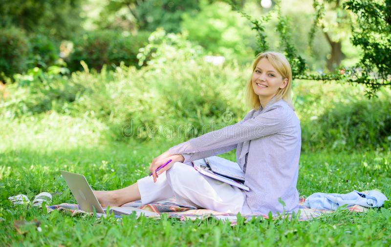 Woman with laptop sit grass meadow. Best jobs to work remotely. Stay free with remote job. Business lady freelance work. Outdoors. Remote job concept. Managing stock photo