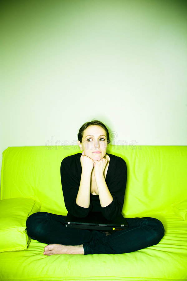 Woman with laptop on sofa royalty free stock photo