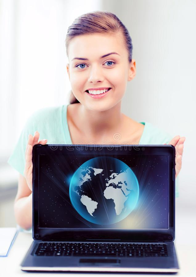 Woman with laptop and sphere globe. News, technology and environment concept - woman with laptop and sphere globe royalty free stock image