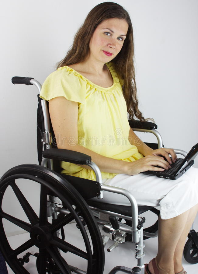 Woman With Laptop In Wheelchair Royalty Free Stock Photo