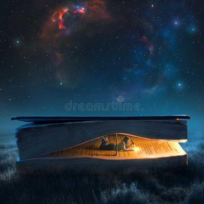 Woman reading at night. A woman in a large book reads by flashlight under a night sky royalty free stock images