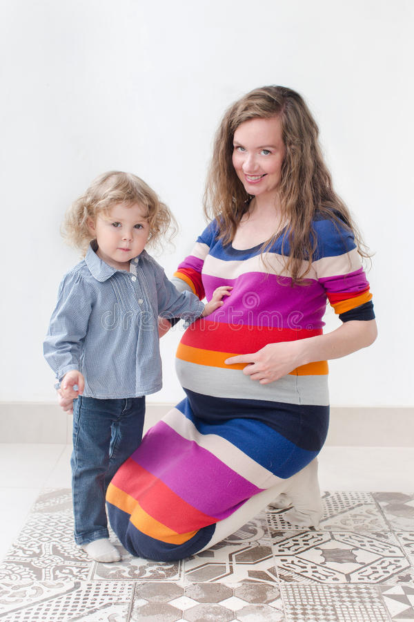 Woman in last month of pregnancy, child portrait stock photography