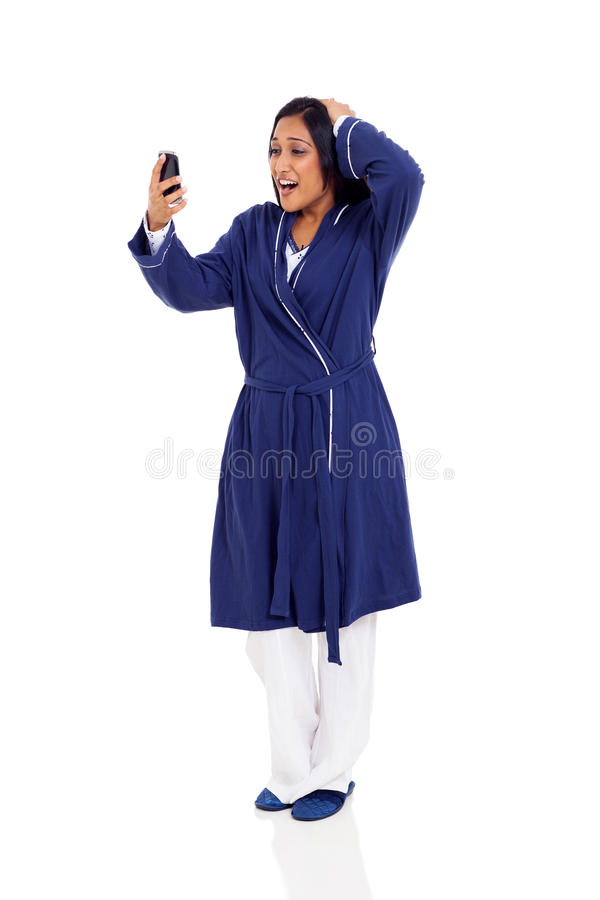 Woman late work. Young indian woman over slept and late for work stock photos