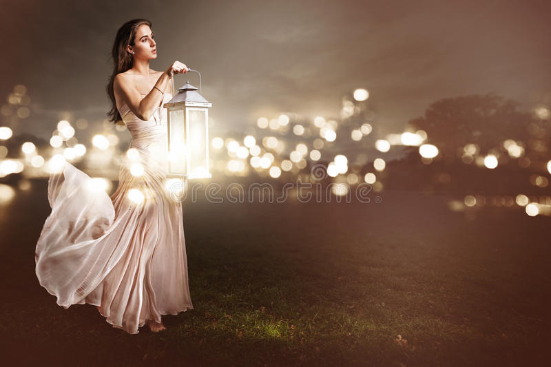 Woman with a latern. Beautiful woman with a latern