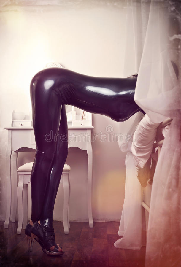 Woman and latex. Woman in latex in bedroom stock photos