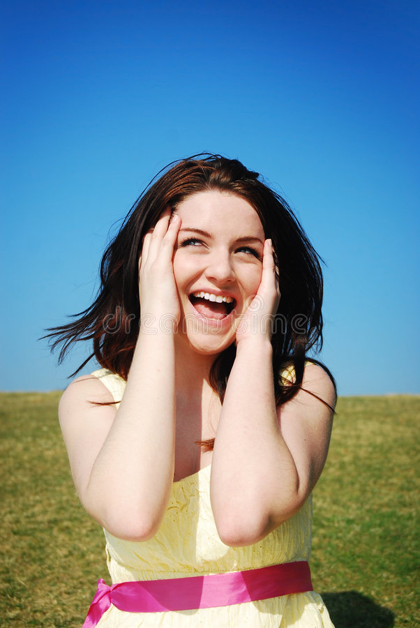 Download Woman laughing in field stock photo. Image of brunette - 9193250
