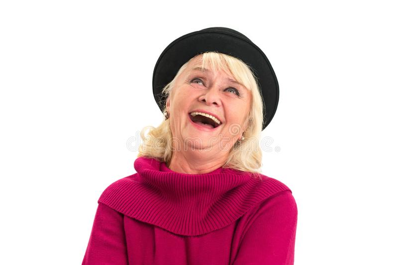 Woman laughing and looking up. Cheerful senior female isolated royalty free stock photo