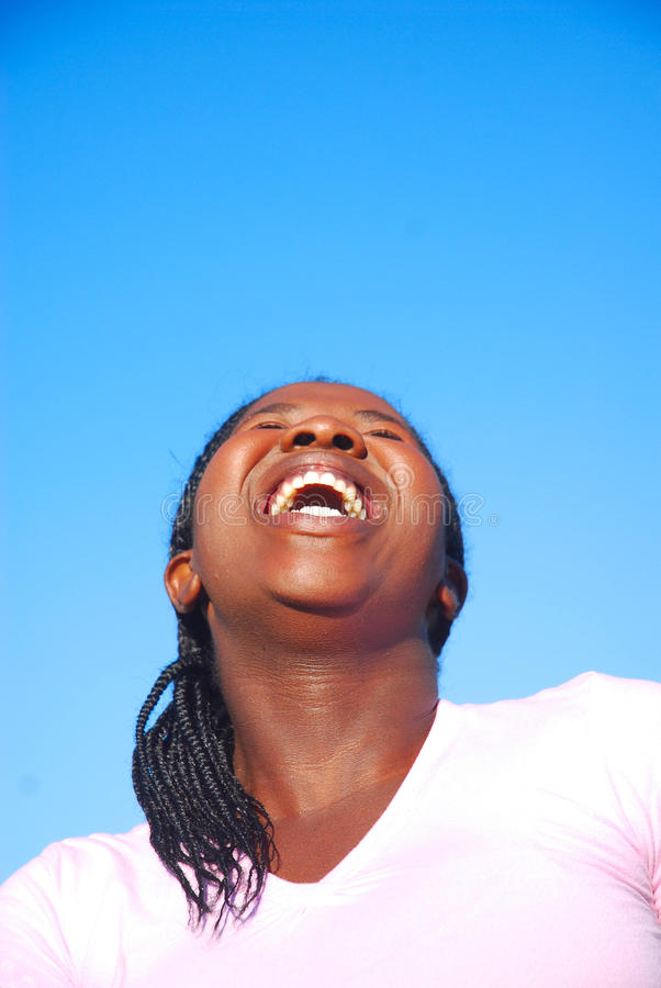 Woman laughing out loud stock photo