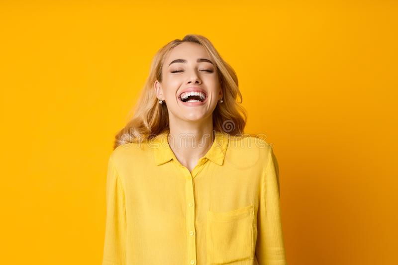 Woman Laughing Out Loud, Hearing Funny Joke royalty free stock photos