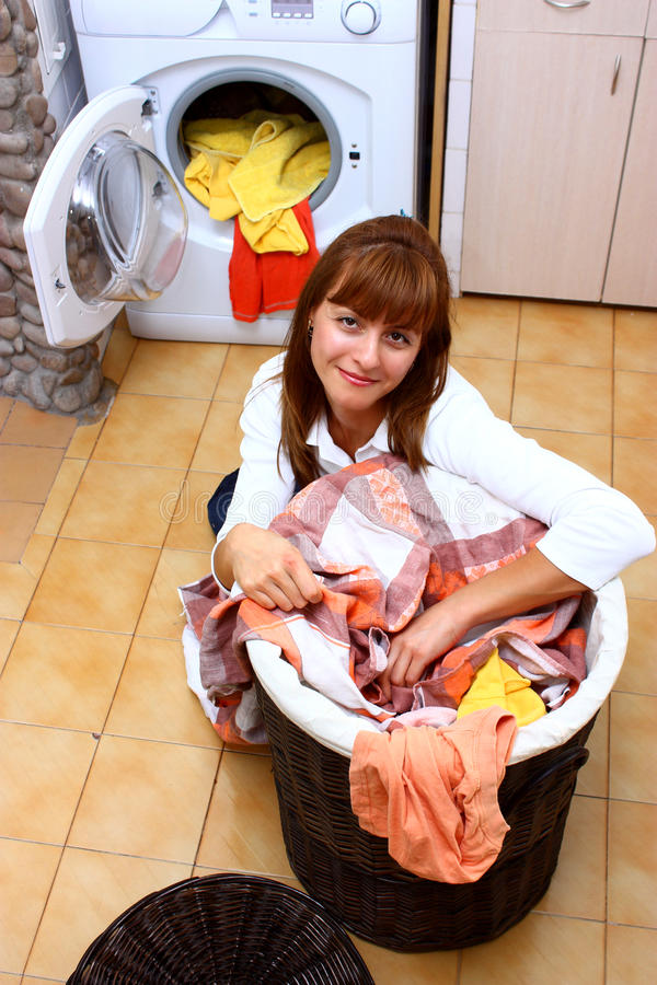 Woman and laundry stock images