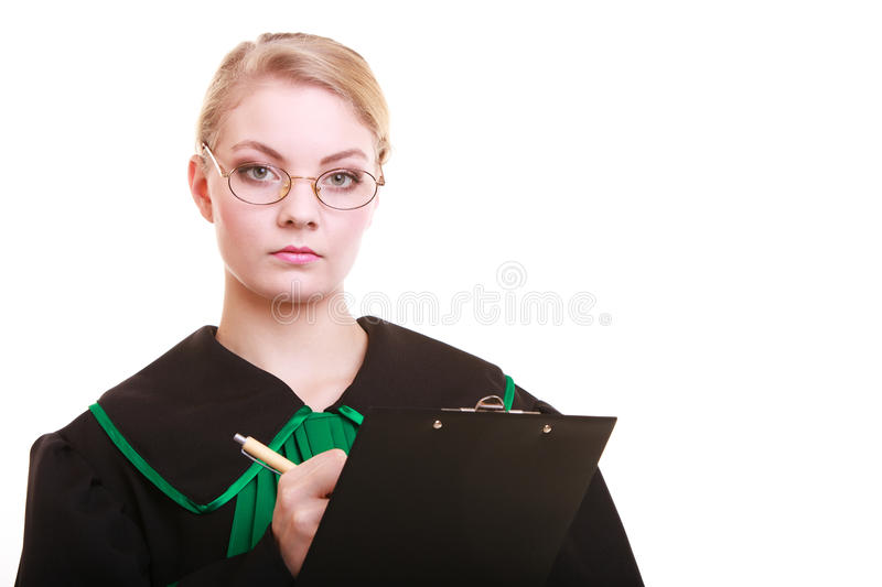 Woman lawyer attorney in classic polish gown writing on clipboard royalty free stock photo