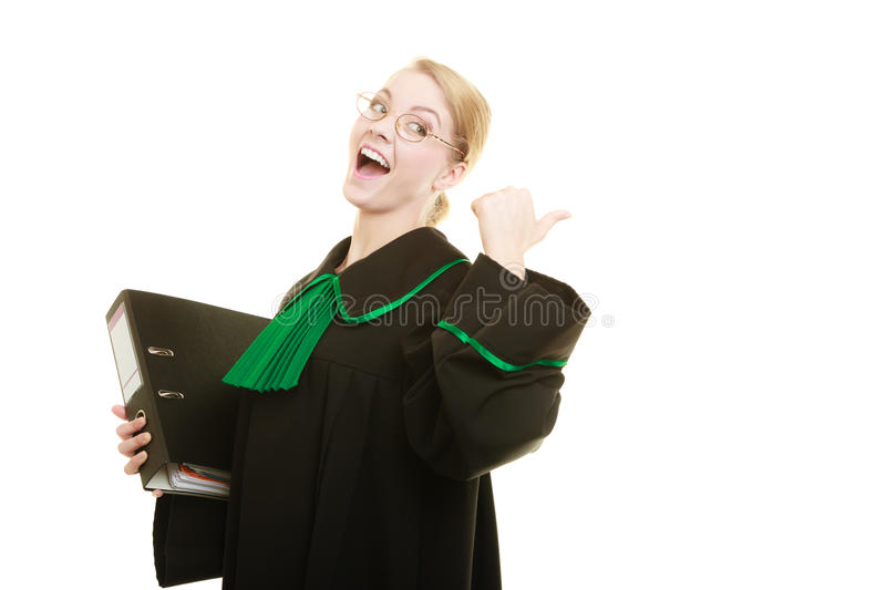 Woman lawyer with file folder or dossier. Law court or justice concept. Young woman lawyer attorney wearing classic polish black green gown with file folder or stock images
