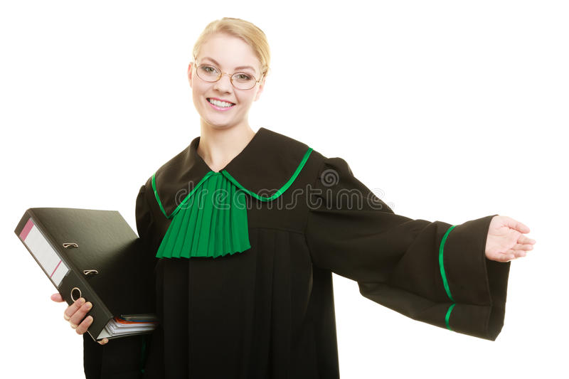Woman lawyer with file folder or dossier. Law court or justice concept. Young woman lawyer attorney wearing classic polish black green gown with file folder or stock photography
