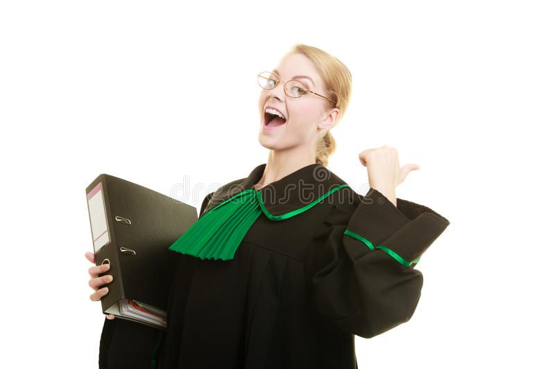 Woman lawyer with file folder or dossier. Law court or justice concept. Young woman lawyer attorney wearing classic polish black green gown with file folder or stock photo