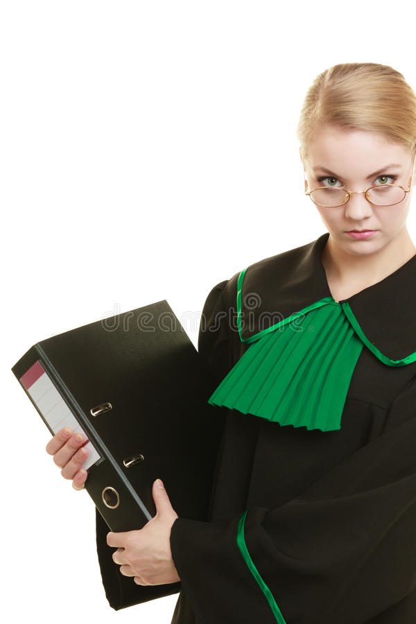 Woman lawyer with file folder or dossier. Law court or justice concept. Young woman lawyer attorney wearing classic polish black green gown with file folder or royalty free stock image