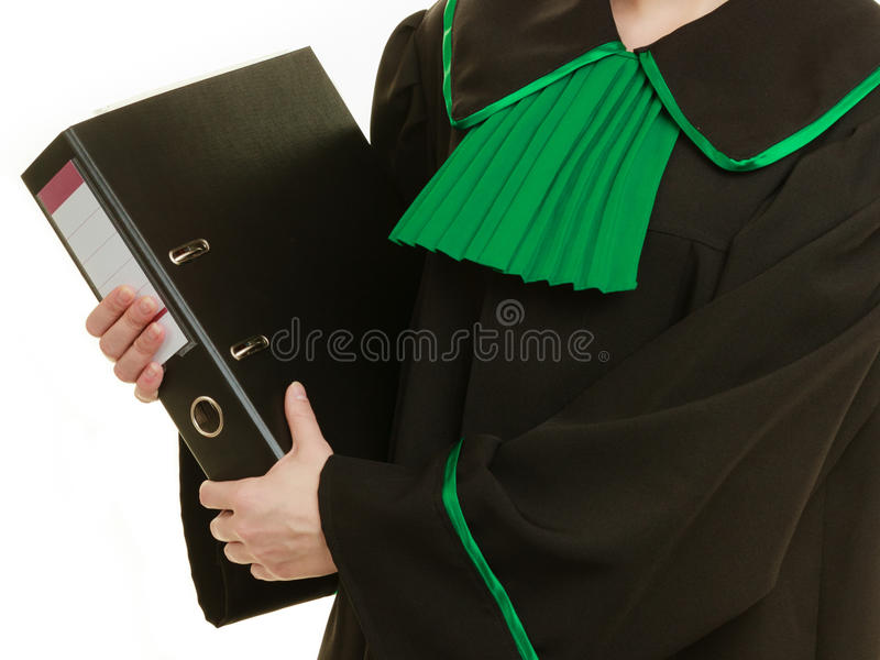 Woman lawyer with file folder or dossier. Law court or justice concept. Young woman lawyer attorney wearing classic polish black green gown with file folder or stock photos