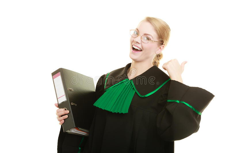 Woman lawyer with file folder or dossier. Law court or justice concept. Young woman lawyer attorney wearing classic polish black green gown with file folder or stock image