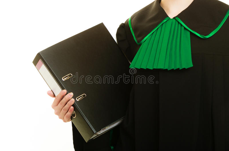 Woman lawyer with file folder or dossier. Law court or justice concept. Young woman lawyer attorney wearing classic polish black green gown with file folder or royalty free stock photos