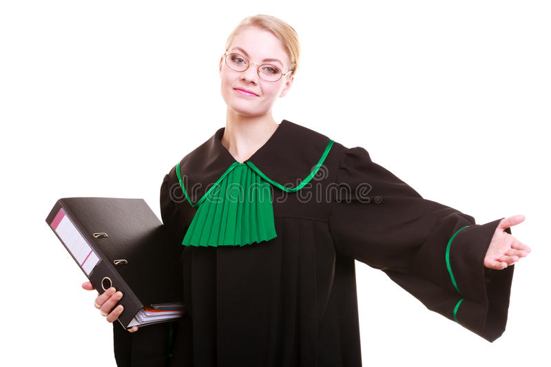 Woman lawyer with folder invitating hand sign. Law court or justice concept. Young woman lawyer attorney wearing classic polish (Poland) black green gown with stock image