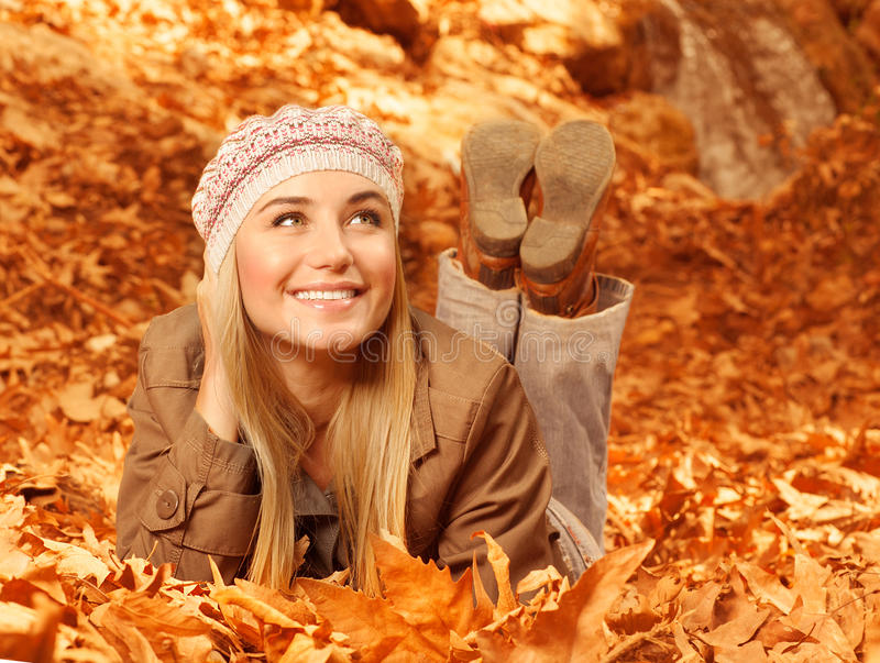 Download Woman Lay Down On Autumnal Foliage Stock Photo - Image: 27353336