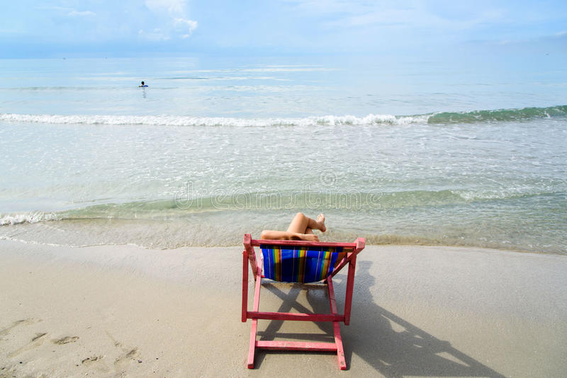 Woman lay on pink beach chair royalty free stock image