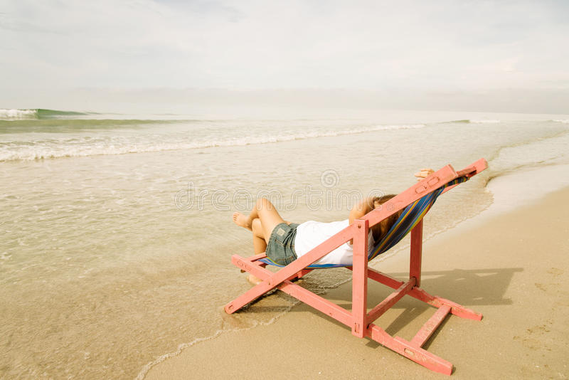 Woman lay on pink beach chair royalty free stock photos