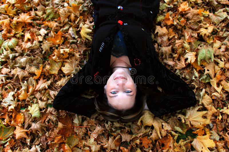 Download Woman Laying In Autumn Leaves Stock Photo - Image: 16693494