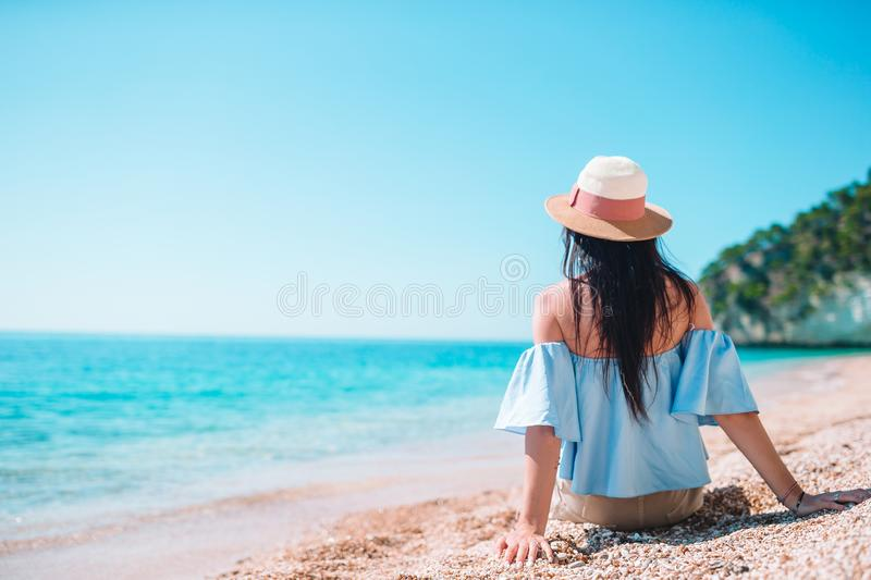Woman laying on the beach enjoying summer holidays looking at the sea royalty free stock images
