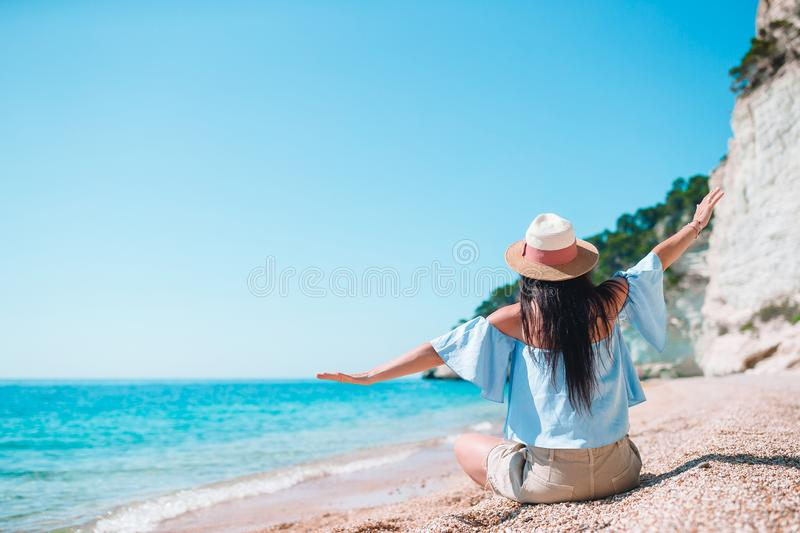 Woman laying on the beach enjoying summer holidays looking at the sea stock photos