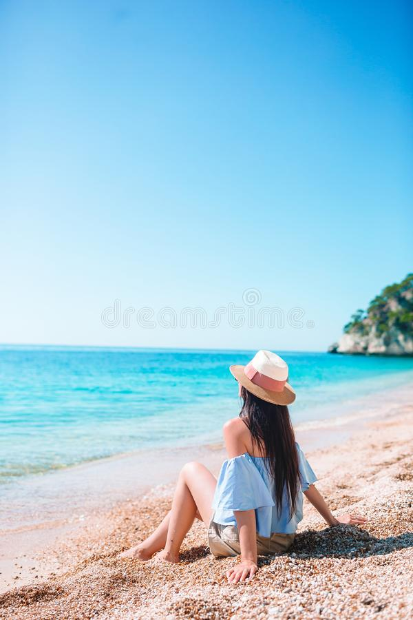 Woman laying on the beach enjoying summer holidays looking at the sea royalty free stock photography