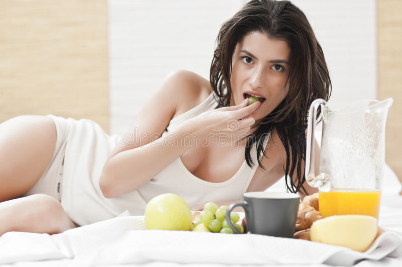 Download Woman Laying On Bed And Having Breakfast Stock Image - Image: 22091857