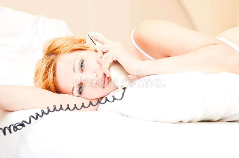Download Woman Laying On Bed Talking On Cordless Telephone Stock Photo - Image: 14833146