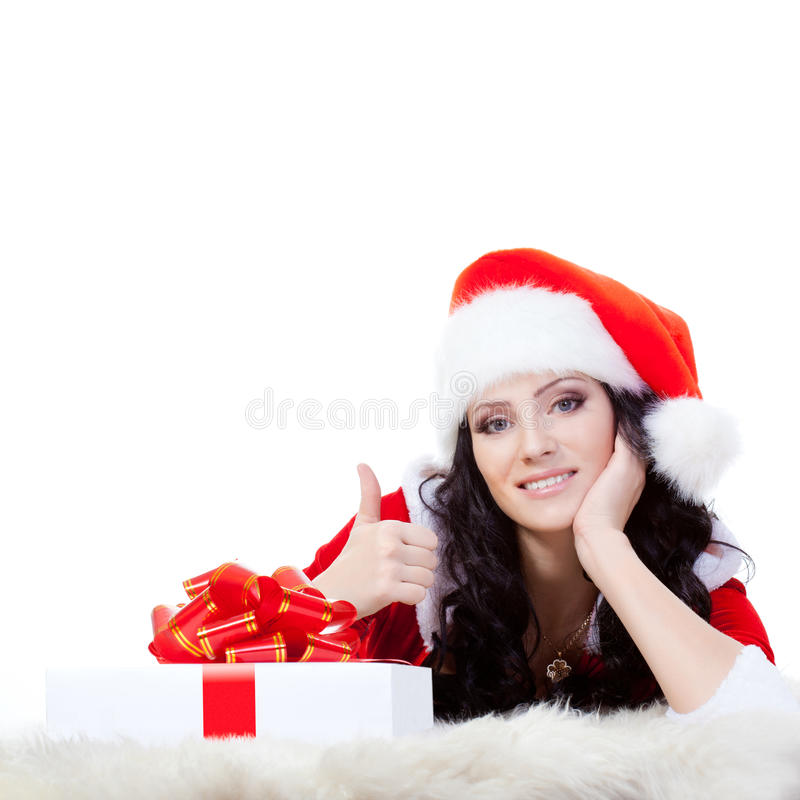 Woman laying on the floor with giftbox royalty free stock photo