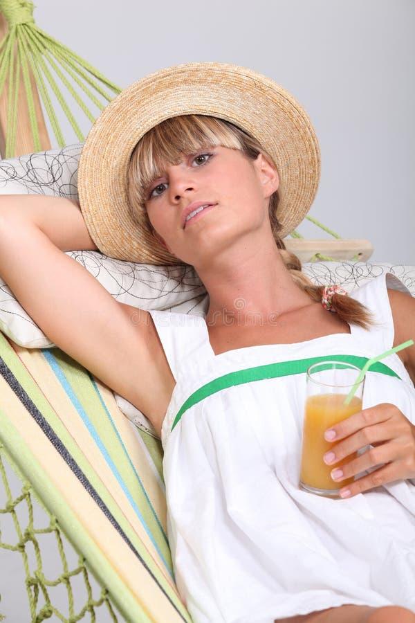 Woman laying in hammock royalty free stock photos