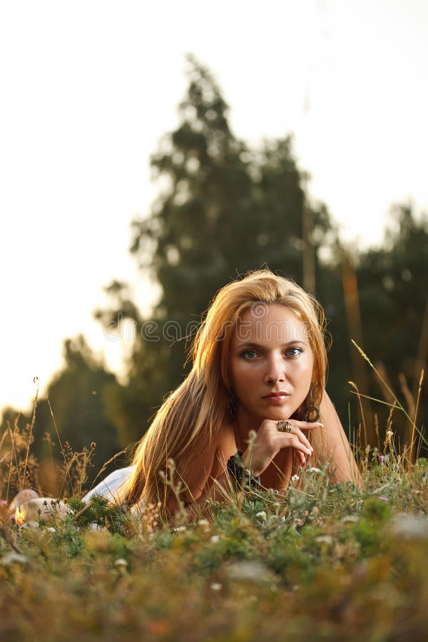 Woman laying on a meadow royalty free stock photo