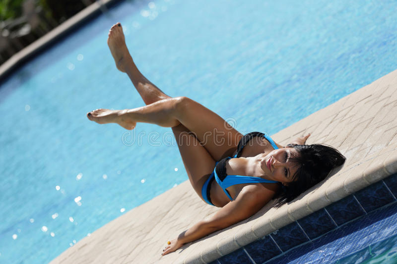 Woman laying by the pool royalty free stock photography