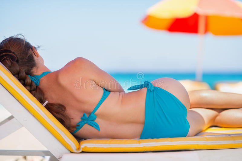 Woman Laying On Sunbed On Beach Stock Images