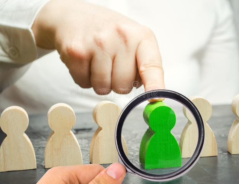 Woman leader chooses the person in the the team. Human Resource Management. Talented worker. Hiring staff. Employee search. Promote. Choosing a new leader in stock photos