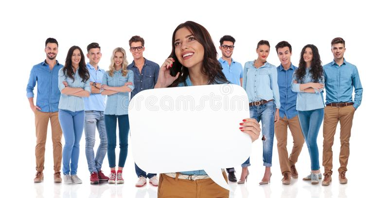 Woman leader holding speech bubble while speaking on the phone stock photos