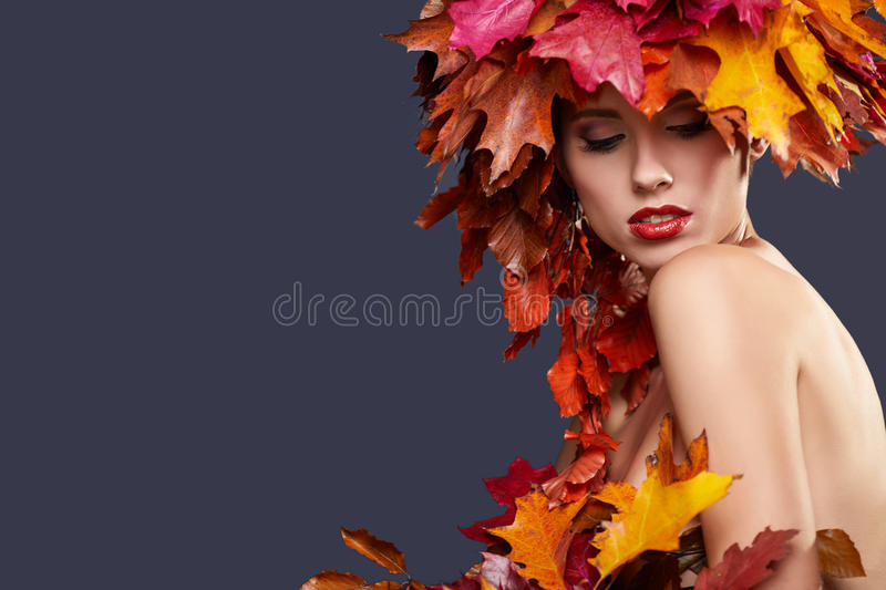 Woman with leafs on head in autumn concept stock photography