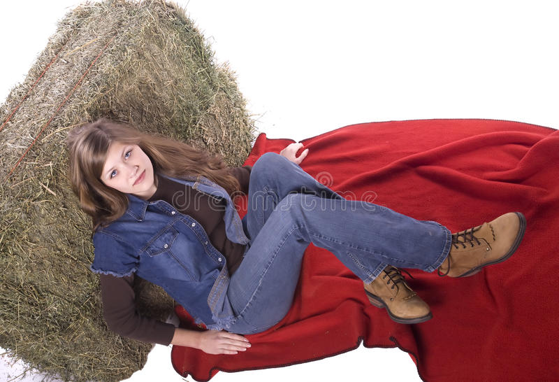 Woman leaning against hay sitting on blanket stock photos