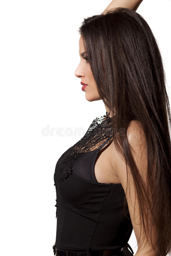 Woman leaning against the wall royalty free stock photography