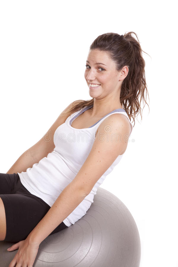 Woman leaning back on fitness ball