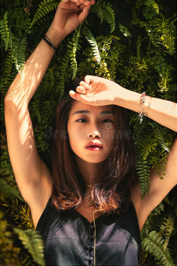 Woman Leaning Behind Fern Plant While Raising Both Hands Free Public Domain Cc0 Image